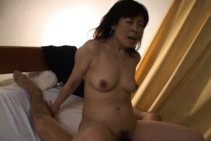 Hitomi Kurosaki Lovely mature Asian model is hot and sexy