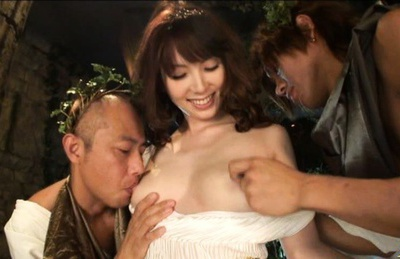 Yui Hatano dressed up like a Roman takes two meat sticks.
