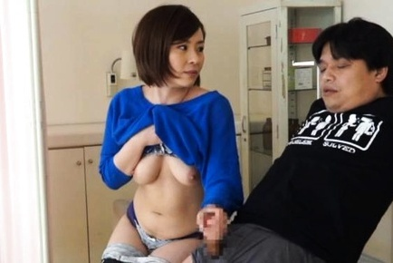 Busty Japanese mature babe teases cock with warm handjob