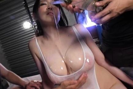 Stunning milf with oiled body Sena Minami sucks and swallows